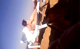 Milf in spiaggia dal culo stupendo
